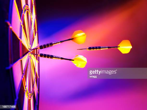 light up the target in darts - possible stock pictures, royalty-free photos & images