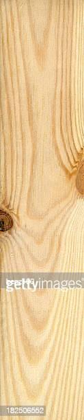 A light wooden plank on a black background