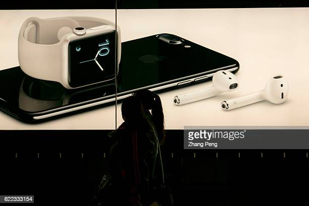 A lightbox shows the new iPhone 7 and wireless earbud in an Apple Store Because of the competition from the domestic brands like Xiaomi and Huawei...