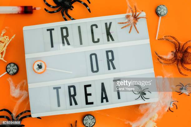 lightbox with halloween message in orange blackground - halloween party stock photos and pictures