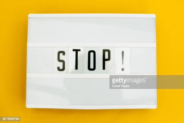 lightbox with ' stop' message on yellow background