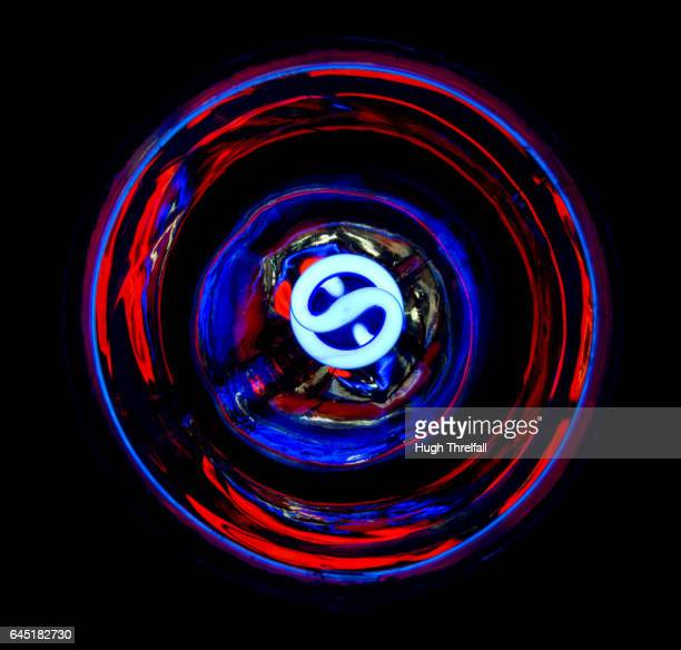 lightbulb and shade from below producing an abstract pattern - hugh threlfall stock pictures, royalty-free photos & images