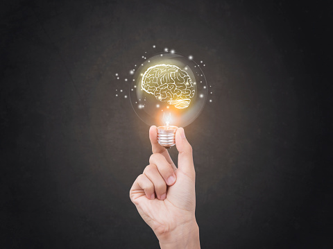 lightbulb brainstorming creative idea abstract icon on business hand. 622315182