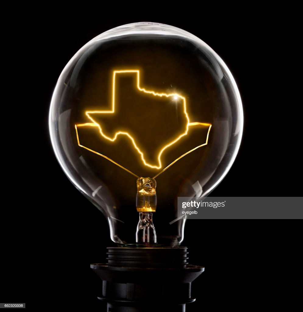 Lightbulb with a glowing wire in the shape of Texas (series) : Stock Photo
