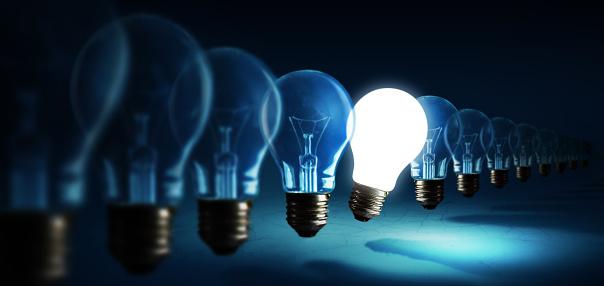 Lightbulbs on blue background, idea concept 1018003646