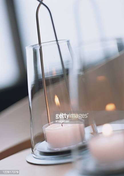 Lighted candles in candleholders