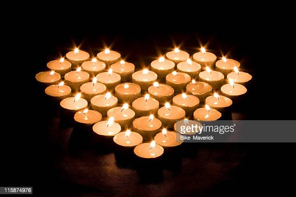 Lighted candles making a heart shape