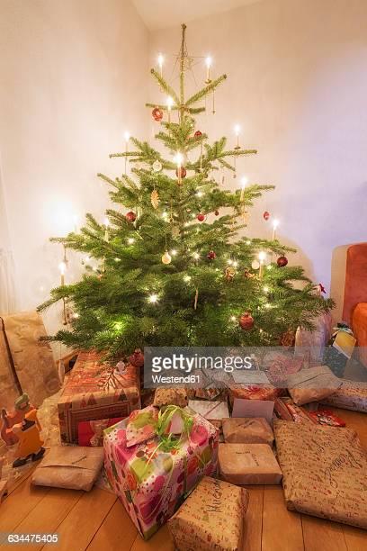 Lighted Christmas tree and Christmas presents