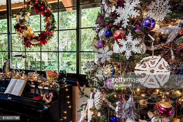 Lighted Christmas Tree by the Wreath and Piano