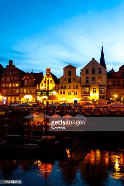 lighted gable houses at stint market, lueneburg, germany - lüneburg stock pictures, royalty-free photos & images
