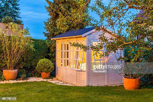 lighted garden shed - shed stock pictures, royalty-free photos & images