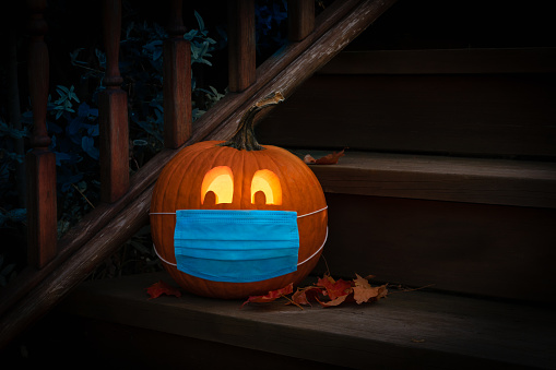 Lighted Halloween Pumpkin Jack o Lantern Wearing Covid PPE Mask On Steps 1272072577