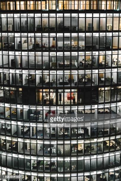 lighted modern office building at night, potsdamer platz, berlin, germany - fensterfront stock-fotos und bilder