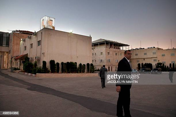 A lighted sign of late Palestinian leader Yasser Arafat is seen at sunset as security works ahead of a meeting between US Secretary of State John...