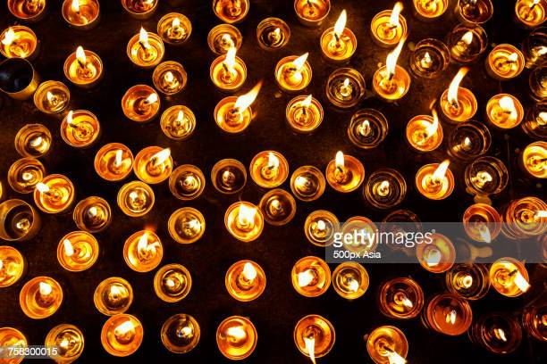 Lighted tea lights and candles, China