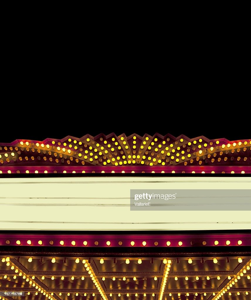 Lighted Theater Marquee at night with copy space areas : Stock Photo