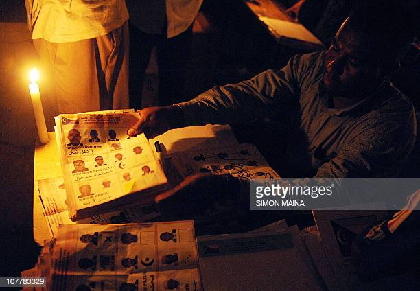 Lighted with candles Comoran electoral agents count ballots on December 26 2010 in Moroni after the Indian Ocean archipelago voted today for a new...