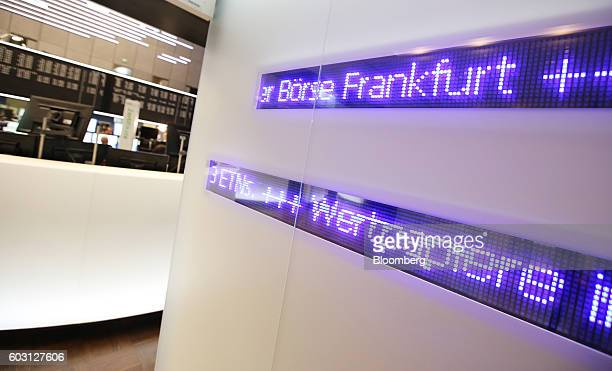 A lightemitting diode display sits on a wall inside the Frankfurt Stock Exchange in Frankfurt Germany on Monday Sept 12 2016 EON SE cut most ties to...