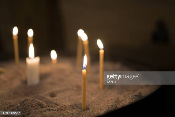 lightened candles inside a church - orthodox christmas stock pictures, royalty-free photos & images