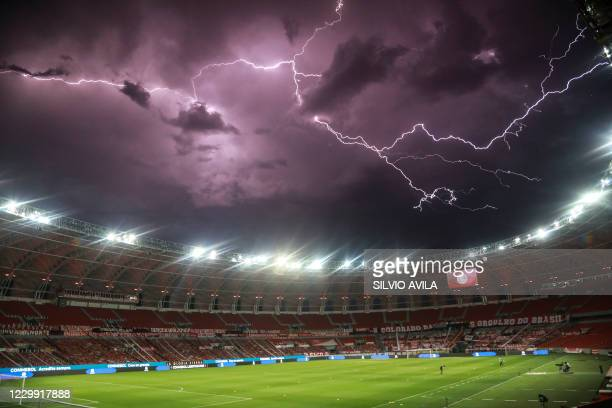 Lightening sparks in the sky atop of the of the empty Beira Rio stadium in Porto Alegre, Brazil, before the start of the closed-door Copa...