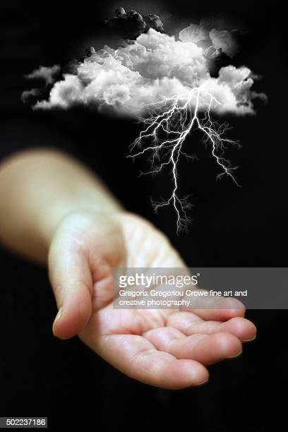 lightening storm in hand - gregoria gregoriou crowe fine art and creative photography stock pictures, royalty-free photos & images