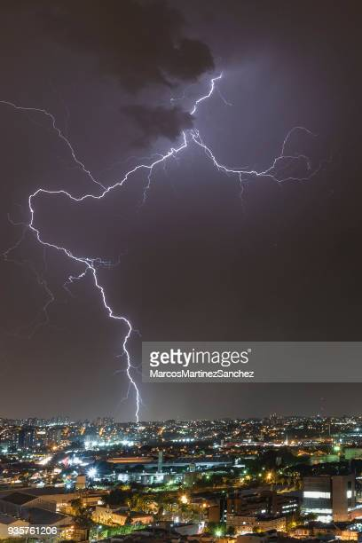 lightening storm night rays - impact stock photos and pictures