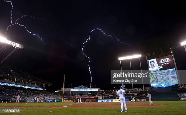 Lightening streaks across the sky in the eighth inning as the Texas Rangers and Kansas City Royals play at Kauffman Stadium in Kansas City Missouri...