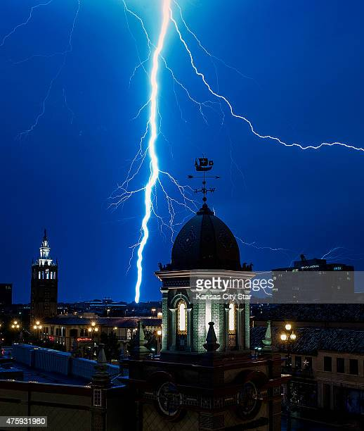 Lightening strikes near the Country Club Plaza as thunderstorms move through the area on Thursday June 4 in Kansas City Mo