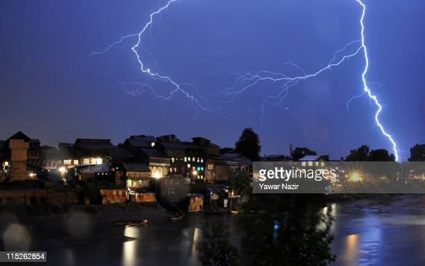 Lightening strikes over the river Jehlum on June 5 2011 in Srinagar the summer capital of Indian administered Kashmir India A hailstorm coupled with...