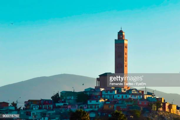 Lighthouse Against Clear Blue Sky In City