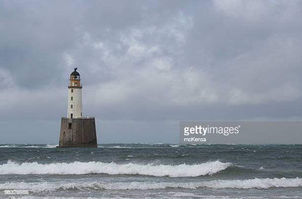 lighthouse against grey sky, rattray head, scotland - rattray head stock pictures, royalty-free photos & images