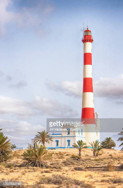 lighthouse against sky - djerba stock pictures, royalty-free photos & images