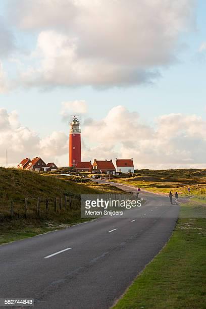 Lighthouse amidst dune landscape