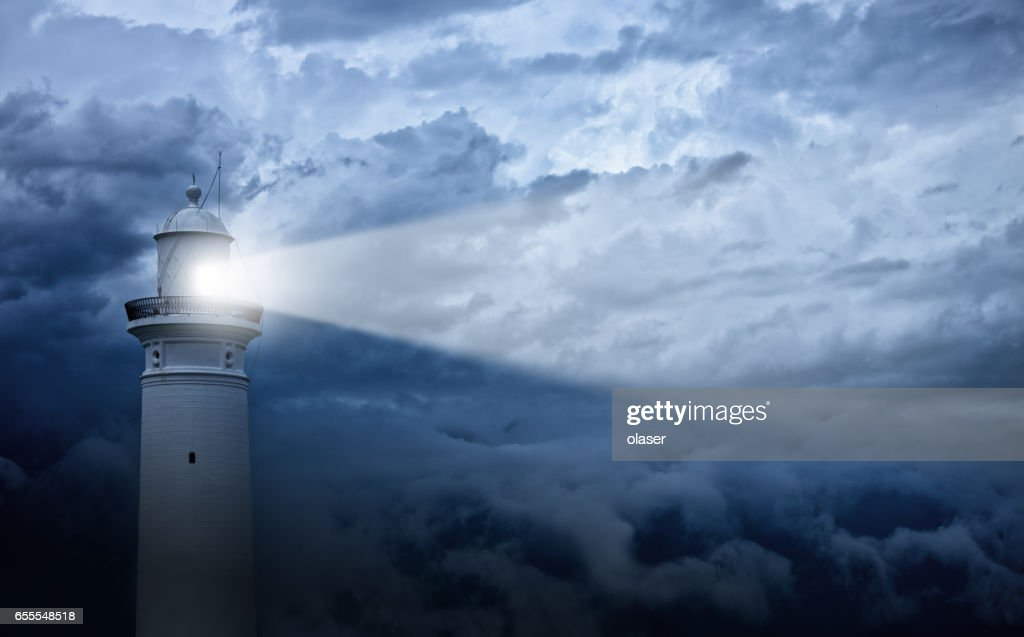 Lighthouse and bad weather in background : Stock Photo