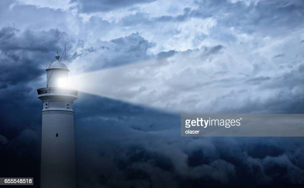 lighthouse and bad weather in background - storm stock pictures, royalty-free photos & images