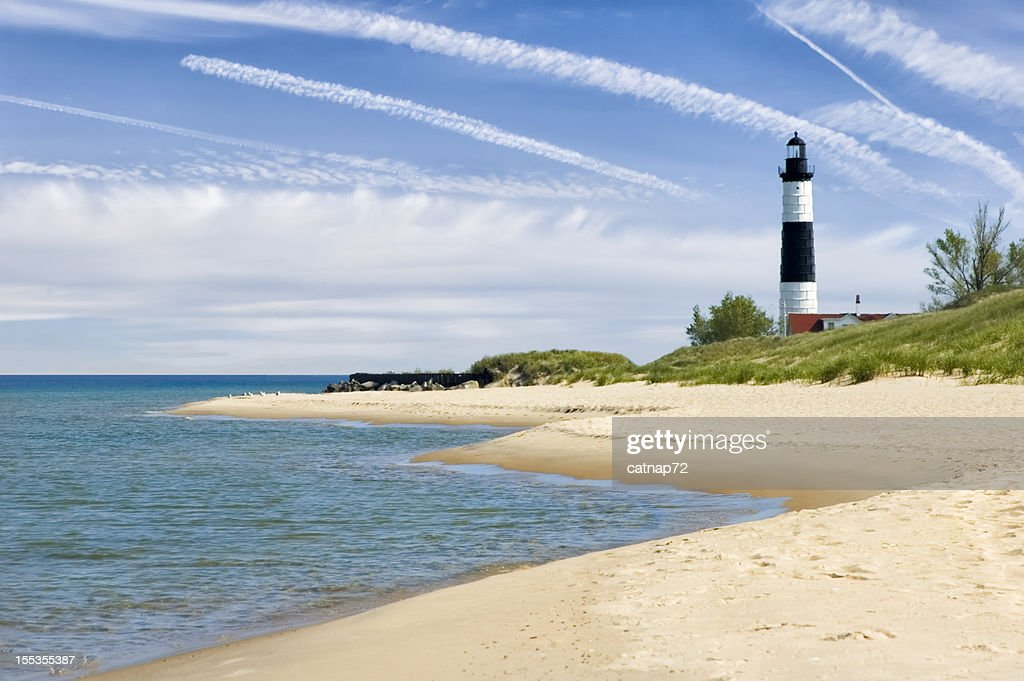 Lighthouse and Beach in Summer with Dramatic Sky Background : Stock Photo