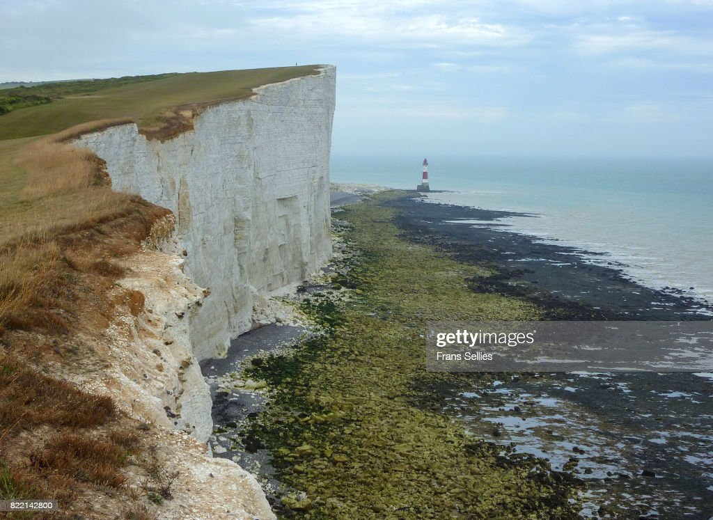 Lighthouse and chalk cliffs of Beachy Head, England : Stock Photo
