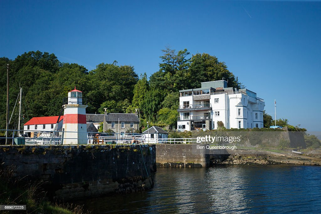 Lighthouse and hotel at Crinan Sea Lock : Stock Photo