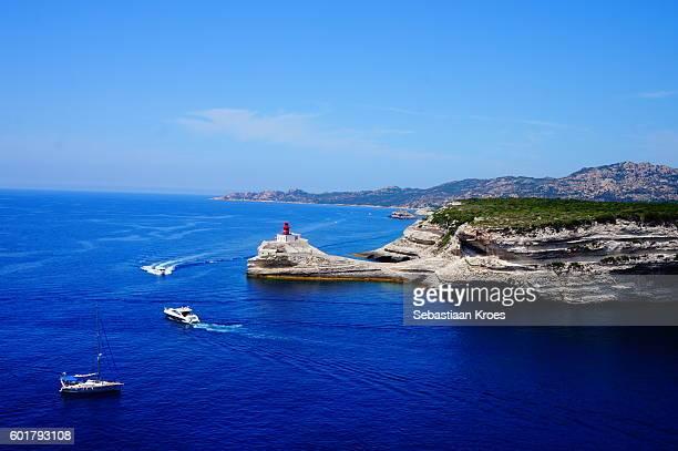 Lighthouse and passing boats, Bonifacio, Corsica, France