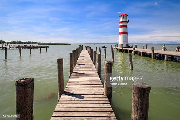 lighthouse and pier in podersdorf, austria - frans sellies stockfoto's en -beelden