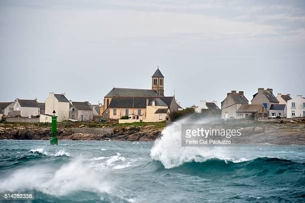 Lighthouse and sea wave at Île de Sein Brittany region in France