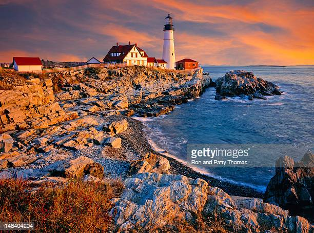 A lighthouse and shoreline on the coast of Maine, USA
