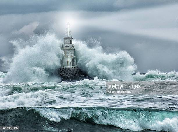 lighthouse and storm - gale stock photos and pictures