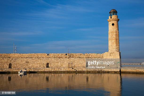 Lighthouse and wall at old Venetian harbour in Rethymno (Rethymnon), island of Crete, Greece, Mediterranean