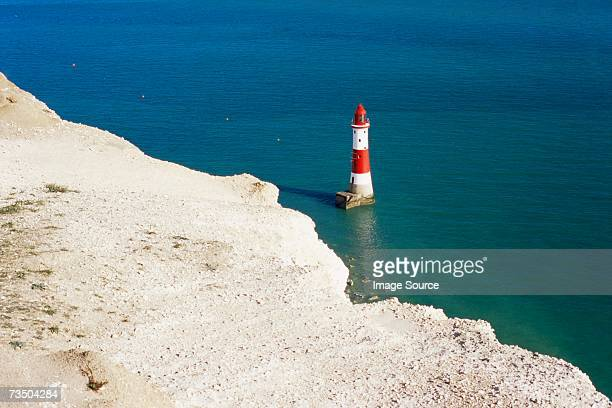 lighthouse at beachy head - beachy head stock photos and pictures
