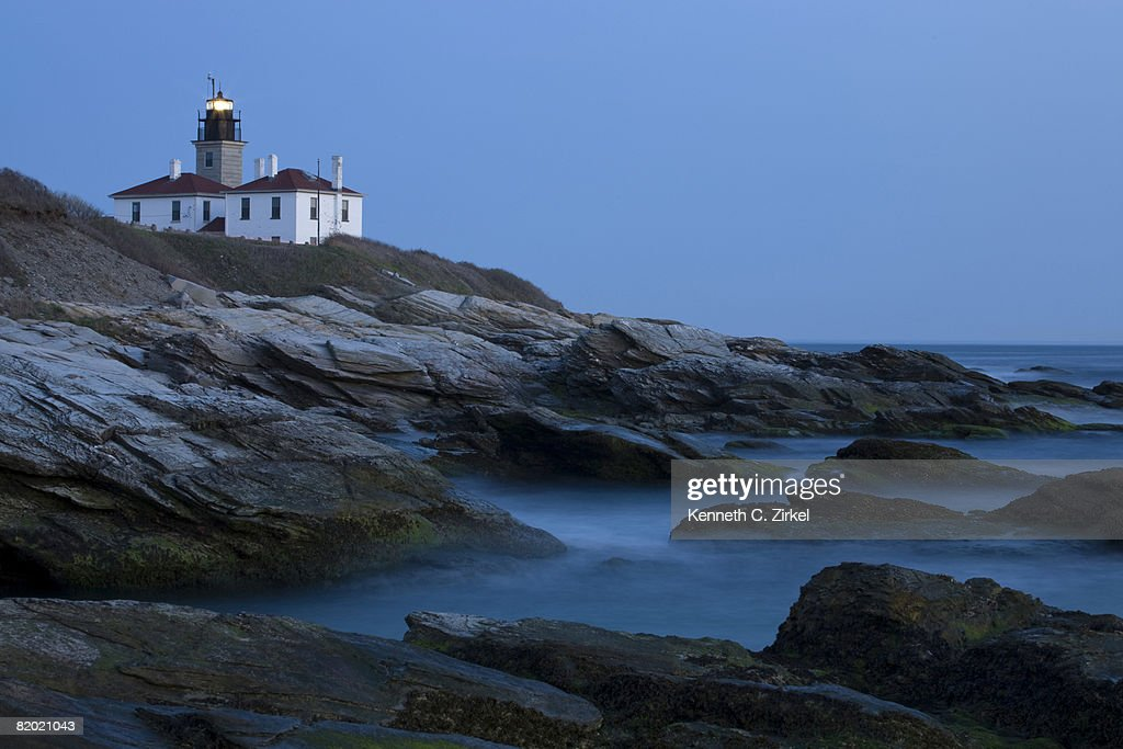 Lighthouse at Beavertail State Park, Jamestown, RI, at dusk. : Stock Photo
