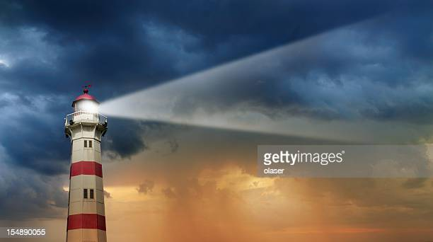 lighthouse at dawn, bad weather in background - guidance stock pictures, royalty-free photos & images