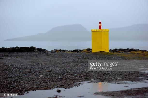 lighthouse at fjord of eskifjörður, iceland - austurland stock-fotos und bilder