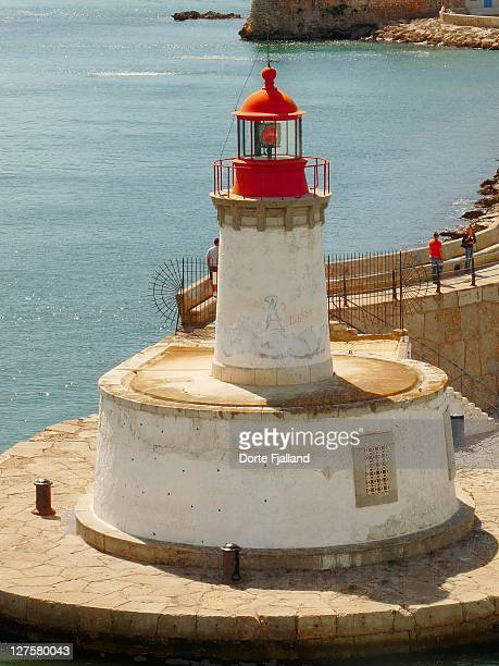 lighthouse at harbour of eivissa - dorte fjalland stock-fotos und bilder