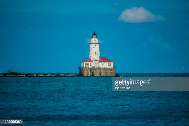 lighthouse at sea during summer - ken ilio stock photos and pictures
